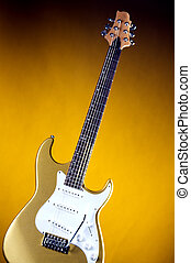 Gold Electric Guitar isolated on Yellow