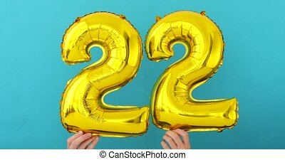 Gold foil number 22 twenty two celebration balloon on blue ...