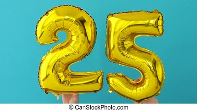 Gold foil number 25 twenty five celebration balloon on a ...
