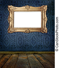 gold frame hanging on a wall in old gallery - gold old style...