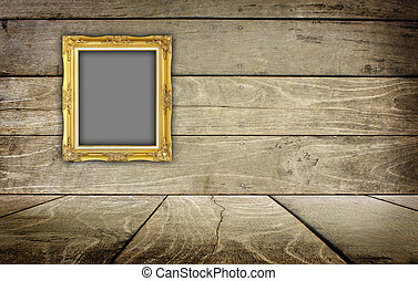 gold frame in interior room with wooden wall background.