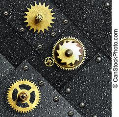 Gold gears against ferrous metal...