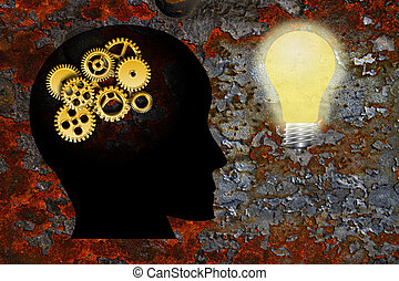 Gold Metal Gears on Human Head Silhouette and Lightbulb on Rusty Grunge Texture Background