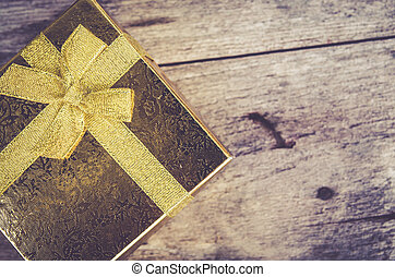 gold gift box on wood background