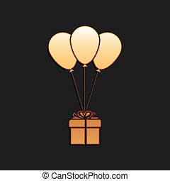 Gold Gift box with balloons icon isolated on black background. Long shadow style. Vector