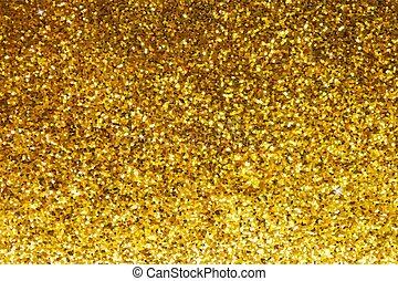 Gold glittery texture. Glitter golden background