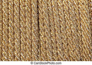 Gold haberdashery ribbon for sale in a haberdashery shop.