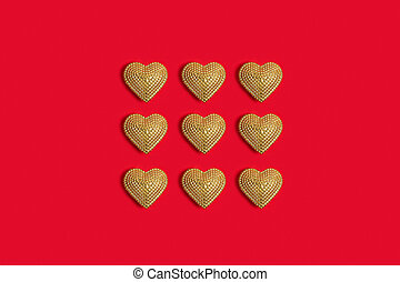Gold heart on red background