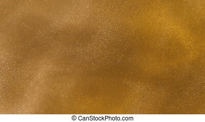 Gold ink in water shooting with high speed camera. Golden...