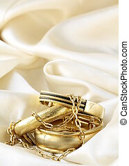 gold jewelry, bracelets and chains