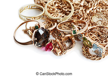 Gold Jewelry On White - Pile of gold jewelry isolated on...