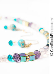 gold jewerly braslete with semiprecious and cristal at white background
