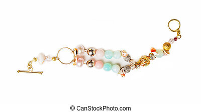 gold jewerly braslete with semiprecious at white background