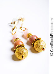 gold jewerly earrings with semiprecious at white background