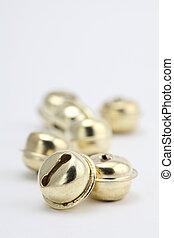 Gold jingle bells - Close-up of gold jingle bells on white ...