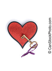gold key on a heart