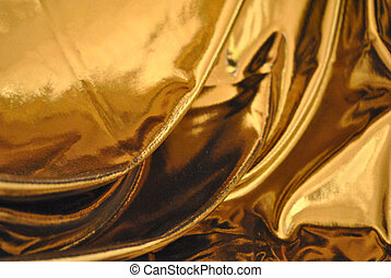 Gold lame cloth drapery background.