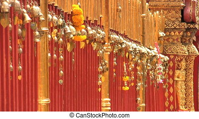 Gold Leaves Dangling At The Temple - A row of small gold...