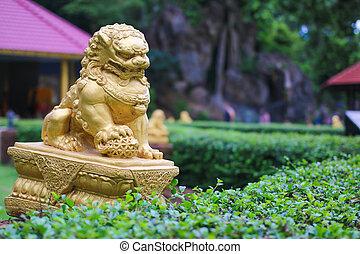 Gold lion sculpture in the gearden