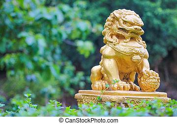 Gold lion statue in the garden