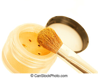 gold make-up eyeshadows and cosmetic brush