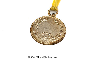 Gold Medal - A gold medal isolated on white with space foe ...