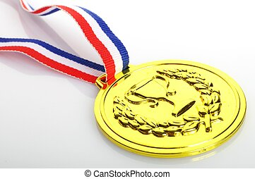 gold medal with ribbon on white background