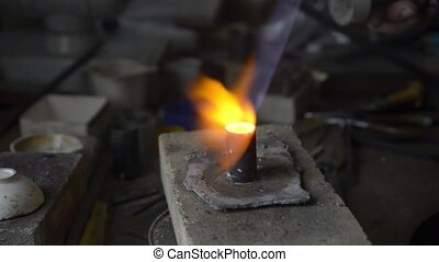 gold metal smelting - The jeweler heats the plaster mold for...