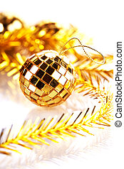 Gold mirror sphere and Christmas tinsel.