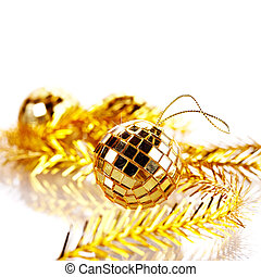 Gold mirror sphere and New Year's tinsel.
