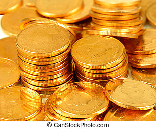 Gold money stack close up. Coins background