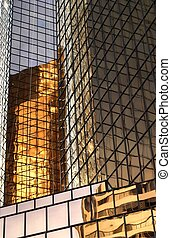 Gold Office Building Reflected - Gold-tinted office buidling...