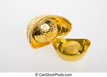 Gold or Chinese gold ingot mean symbols of wealth and prosperity on a background.