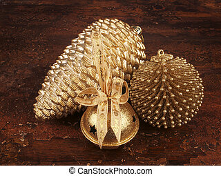 Gold ornaments - gold pine cone, bell and ornament
