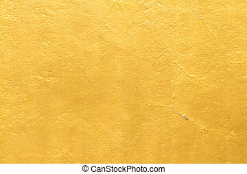 Gold paint on cement wall texture
