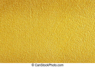 Gold paint on rough cement wall texture background
