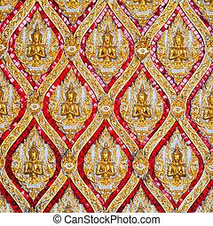 Gold-painted ceramic art of Thai nation. In thai temple, Thailand.