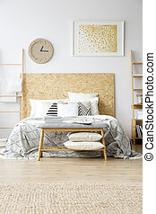Gold painting in boho bedroom
