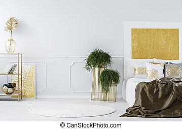 Gold painting in elegant bedroom