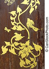 gold painting on old wood door
