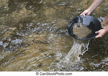 gold panning iin a small stream in northern michigan