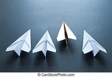 Gold paper plane leader concept