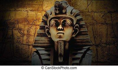 gold pharaoh tutankhamen mask on dark background