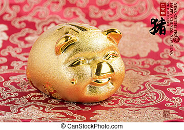 Gold piggy bank, Chinese calligraphy translation: pig. Red ...