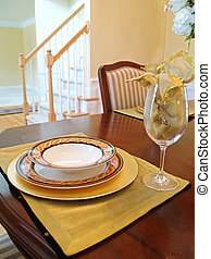 Gold Place Setting - A gold place setting on the dining room...