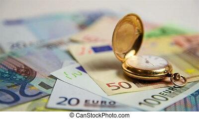 Gold pocket watch - Gold Pocket Watch On Pile Of Euro Bills....