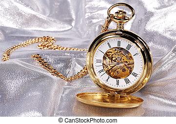 Gold Pocketwatch - Photo of a Gold Pocketwatch