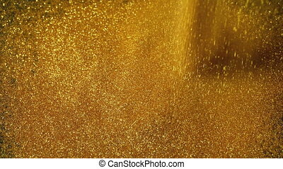 Gold Powder Pours Onto Surface - Gold powder is poured onto ...