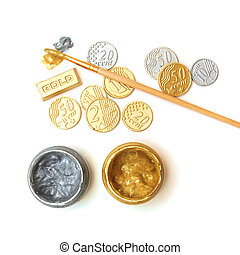 Gold reserve. Concept. Bullion, coins, brush, gold and silver paint cans