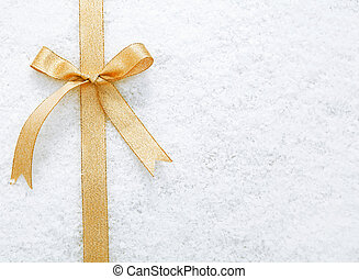 Gold ribbon and bow on snow - Decorative simple gold ribbon...